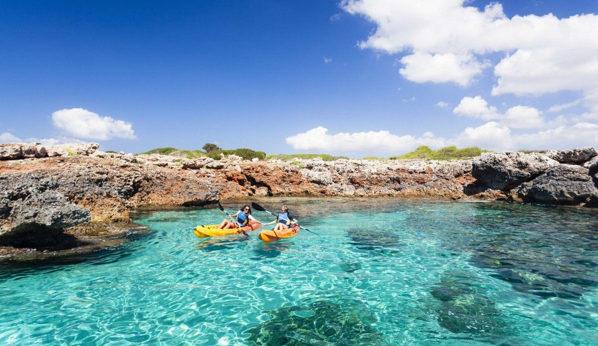 Perfect Summer Holiday Destinations, Mallorca, Tourists with Kayaks