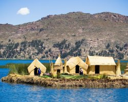 Trend Destination Holiday, Peru, South America, Reed houses on the lake