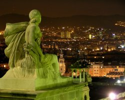 Barcelona, Spain, Statue guarding the city at night