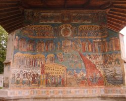 Beautiful Monastery, Voronet, Romania, Outside view Last Judgment painting