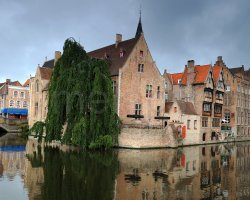 Bruges, Belgium, The Dijver canal with Belfort (Medieval Bell Tower) in background