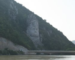 Unique Romanian Destination, Cauldrons of Danube, King Decebal stone carved face far view