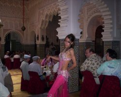 Dance Holiday, Morocco, Belly Dancer in a restaurant