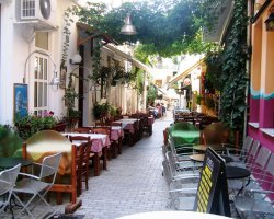 Discover Thassos II, Limenas, Greece, Street with taverns