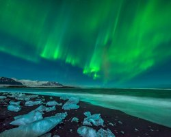 Oddest Beach Holiday, Jokulsarlon Beach, Iceland, Northen Lights over the beach