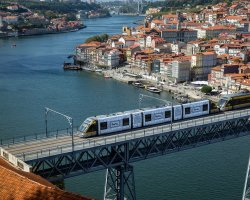 Perfect Summer Holiday Destinations, Porto, City tram over the bridge