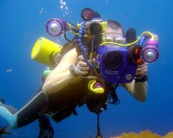 Underwater Tourism, Scuba divers taking photos