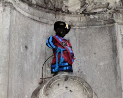 Weird and Funny Monument Holiday, Brussels, Belgium, Manneken Pis dressed