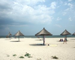 Romantic Wild Beaches Holiday, Gura Portitei, Romania, Beach with parasols